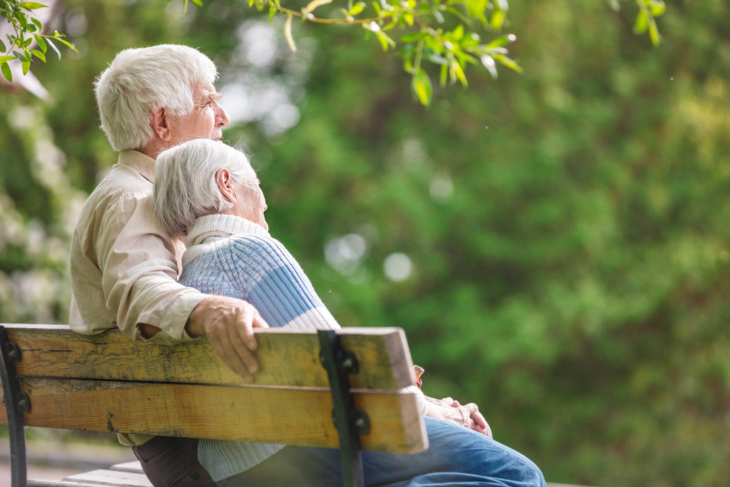 Senior Couple on Bench Outside